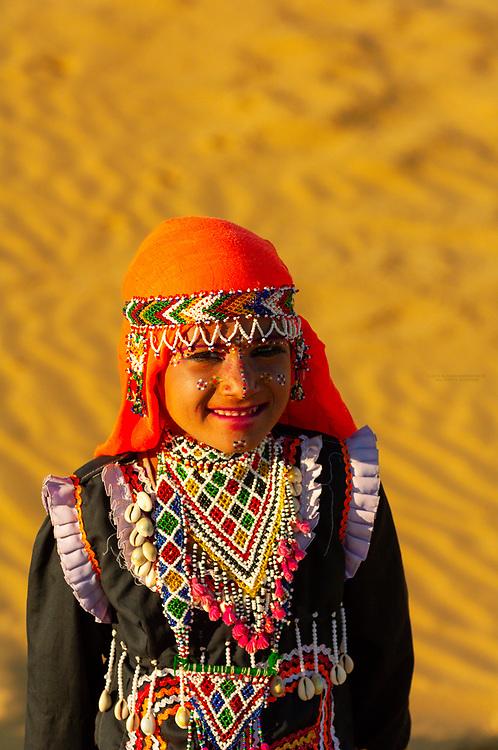 Girl wearing traditional Rajasthani desert costume, Kanoi Sand Dunes, Thar Desert, near Jaisalmer, Rajasthan, India