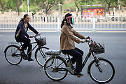 Cyclers during an early morning traffic in the city center of Beijing. Beijing is the capital of the People's Republic of China and one of the most populous cities in the world with a population of 19,612,368 as of 2010.