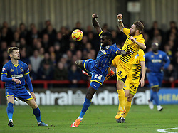 Karleigh Osborne of AFC Wimbledon and Matt Taylor of Bristol Rovers challenge for the ball - Mandatory byline: Robbie Stephenson/JMP - 07966 386802 - 26/12/2015 - FOOTBALL - Kingsmeadow Stadium - Wimbledon, England - AFC Wimbledon v Bristol Rovers - Sky Bet League Two