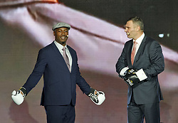 October 1, 2018 - Kiev, Ukraine - Former Boxing Champion LENNOX LEWIS (L) and former heavyweight boxing champion and current Mayor of Kiev VITALI KLITSCHKO (R) are arguing as they watching on the screen and remembering their fight that was in Los Angeles 21 June 2003, during the opening of the 56th World Boxing Convention in Kiev, Ukraine, on 1 October 2018. The WBC 56th congress in which take part boxing legends Evander Holyfield,Lennox Lewis, Eric Morales and about 700 participants from 160 countries runs in Kiev from from September 30 to October 5. (Credit Image: © Serg Glovny/ZUMA Wire)