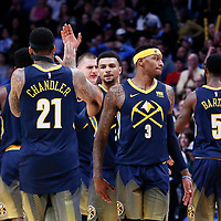 05 April 2018: Denver Nuggets guard Jamal Murray (27) celebrates with Denver Nuggets forward Wilson Chandler (21) next to Denver Nuggets guard Torrey Craig (3) and Denver Nuggets forward Will Barton (5) during the Denver Nuggets 100-96 victory over the Minnesota Timberwolves, at the Pepsi Center, Denver, Colorado, USA.