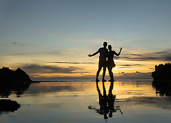 Silhouette of couple embracing on beach during sunset, Nusa lembongang, Bali, Indonesia