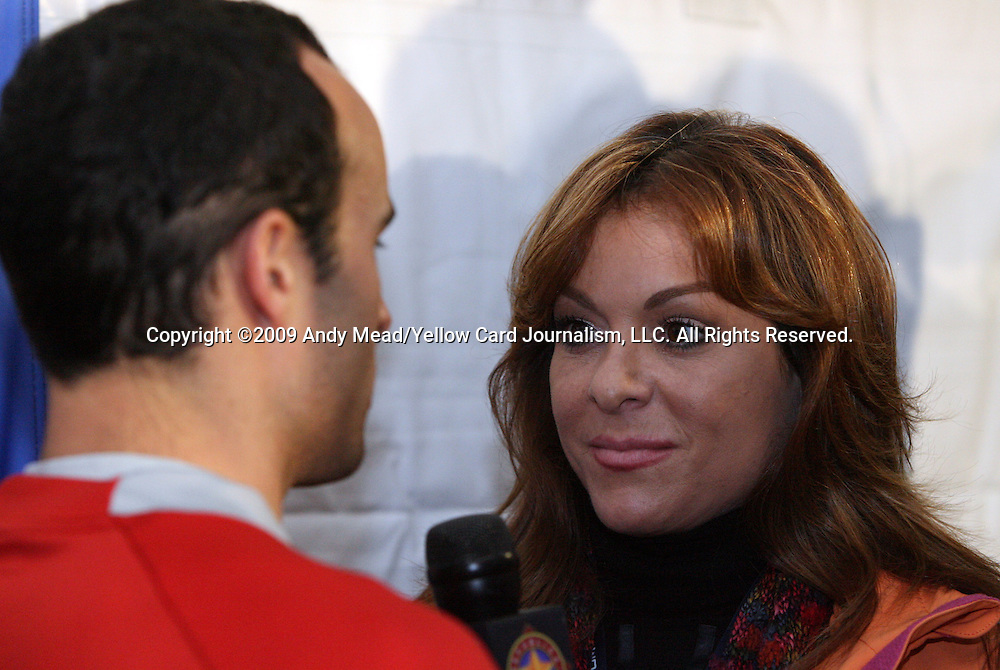 10 February 2009: Forward Landon Donovan (left) is interviewed by Univision television personality Rosana Franco (right). The United States Men's National Team held a press conference at Columbus Crew Stadium in Columbus, Ohio in advance of their FIFA 2010 World Cup Qualifier against Mexico.