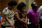 Saymendi Lloyd bows her head during a memorial service for Ebola patient Thomas Eric Duncan at Wilshire Baptist Church on October 8, 2014, in Dallas. (Cooper Neill for The New York Times)