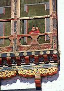 Child watching from carved decorative window, Thimpu, Bhutan