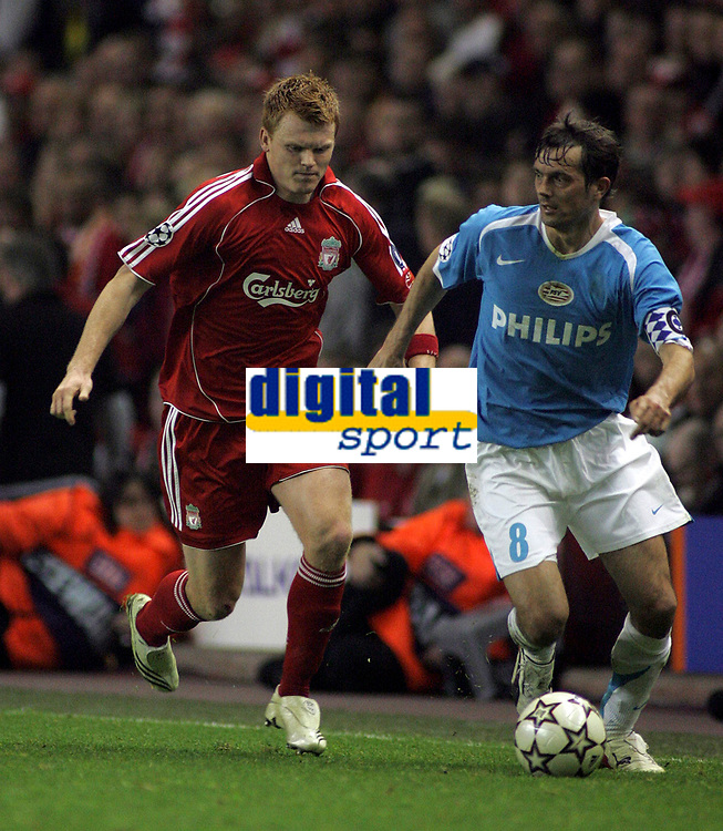 Photo: Paul Thomas.<br /> Liverpool v PSV Eindhoven. UEFA Champions League. Quarter Final, 2nd Leg. 11/04/2007.<br /> <br /> John Arne Riise (L) of Liverpool tries to tackle Phillip Cocu.