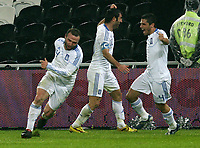 Fotball , 18. november 2009 , Ukraina - Hellas ,  Qualification for World Cup 2010 Season 2009 2010 Donbass Arena Donetsk Ukraine Greece Dimitrios Salpingidis left Greece cheering above be goal to 0 1 together with Georgios Karagounis centre and Niko Laos Spiropoulos right Ukraine Greece <br /> <br /> Norway only