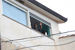 Italy, Riace  - October 6, 2018.Demonstration of solidarity with Domenico Lucano, Mayor of Riace arrested for allegedly aiding illegal immigration. The demonstrators demand the release of the arrested Mayor.Mayor Lucano greets the demonstrators from the window of his home where he is under house arrest (Credit Image: © Albano Angilletta/Ropi via ZUMA Press)