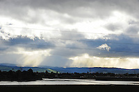 As photographed from the Vietnam Veterans Memorial Hill, chiaroscuro skies churn over Salinas as a Pacific storm brings high winds and occasional heavy rain to the Monterey Bay area. Rain is expected to continue through Thursday this week.