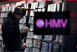 © Licensed to London News Pictures. 15/01/2013. London, UK. The a shopper is seen inside the HMV store at Piccadilly Circus, London, today (15/01/13) after the company called in the receivers. Photo credit: Matt Cetti-Roberts/LNP