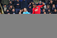 Manchester United forward Odion Ighalo (25) leaps a challenge from Club Brugge defender Simon Deli (17) during the Europa League match between Club Brugge and Manchester United at Jan Breydel Stadion, Brugge, Belguim on 20 February 2020.