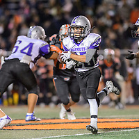 110714       Adron Gardner/Independent<br /> <br /> Miyamura Patriot Toshio Herrera (25) makes a run during the district 1-5A championship against the Aztec Tigers at the Fred Cook Memorial Stadium in Aztec Friday.