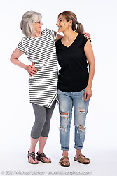 Jeanne Robinson (L) and Karla Nunez at the Intercambio portrait Shoot. Longmont, CO, USA. June 6, 2021. Photography ©2021 Michael Lichter. Usage rights granted to Intercambio Uniting Communities and its assigns.