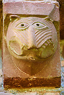 Norman Romanesque exterior corbel no 48  -  sculpture of.a grotesque creature with a long snout and fierce teeth. The Norman Romanesque Church of St Mary and St David, Kilpeck Herefordshire, England. Built around 1140