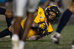 California punt returner Nikko Remigio (4) looks up from the turf after making a fair catch of a Nevada kick during the fourth quarter of an NCAA college football game, Saturday, Sept. 4, 2021, in Berkeley, Calif. (AP Photo/D. Ross Cameron)