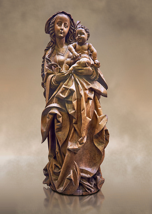 """Wooden Gothic sculpture of the Virgin and Child attributeed to Martin Hoffman from the city of Basle, 1507, Switzerland. From the Commandry of Isenheim, Haut Rhin. This sculpture is probably the """"big and ancient wooden statue of the Virgin"""" cited in 1793 in the inventory of the property of the Commandry of Isenheim.  The vervatious deep folds in the Virgins dress, the laughing child Jesus  and the style of Mary were repeatedly imitated in Basel at the beginning of the sixteenth century. This masterpiece of the German late Gothic sculpture was executed in a Basel workshop and can be attributed to Martin Hoffman. Expressive and enigmatic, the style of this masterpiece is the heir of the sculpture schools of Stragbourg and Veit Stoss Franconian art.  Inv RF 1833 The Louvre Museum, Paris. .<br /> <br /> If you prefer you can also buy from our ALAMY PHOTO LIBRARY  Collection visit : https://www.alamy.com/portfolio/paul-williams-funkystock . Type -    Louvre Madonna     - into the LOWER SEARCH WITHIN GALLERY box. Refine search by adding background colour, place, museum etc<br /> <br /> Visit our MEDIEVAL ART PHOTO COLLECTIONS for more   photos  to download or buy as prints https://funkystock.photoshelter.com/gallery-collection/Medieval-Middle-Ages-Art-Artefacts-Antiquities-Pictures-Images-of/C0000YpKXiAHnG2k"""