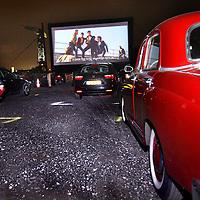 Nederland, Amsterdam, 2 oktober 2014.<br /> drive-in bioscoop op de NDSM werf.<br /> De film Grease met John Travolta en Olivia Newton John  wordt getoond.<br /> <br /> Foto:Jean-Pierre Jans