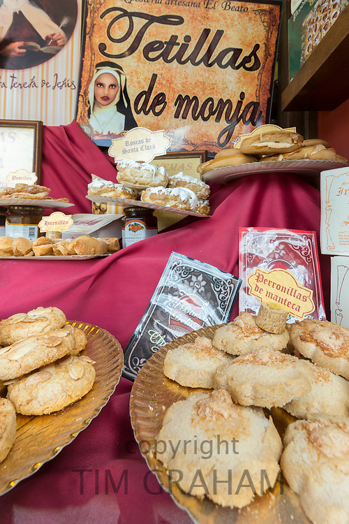 Traditional Spanish biscuits, pastries and cakes as gifts and souvenirs on sale in shop in Avila, Spain