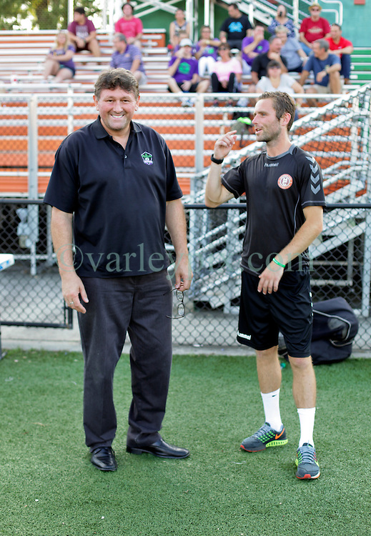 16 June 2016. New Orleans, Louisiana.<br /> NPSL Soccer, Pan American Stadium.<br /> New Orleans Jesters head coach Kenny Farrell with Memphis City FC head coach Christopher Harrington before the game. Jesters lose 1-2, down to 10 men after a 12th minute red card.<br /> Photo; Charlie Varley/varleypix.com