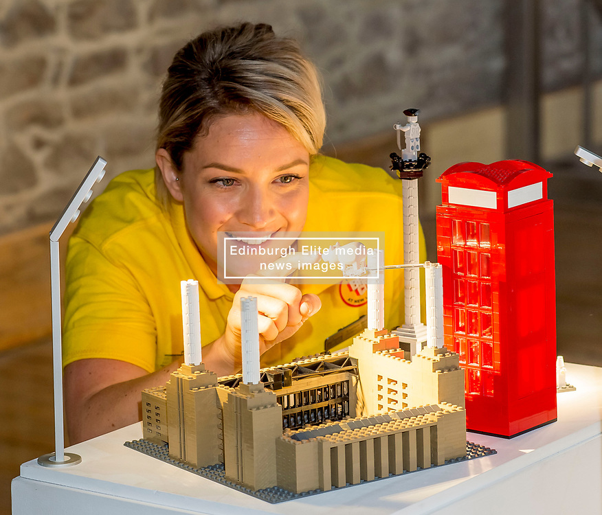 Exhibition & Events Officer with the New Lanark Trust Evelyn Whitelaw checks over one of the exhibition pieces all made entirely from Lego bricks, which goes on display to the public at the New Lanark World Heritage Village from today. <br /> <br /> © Dave Johnston/ EEm