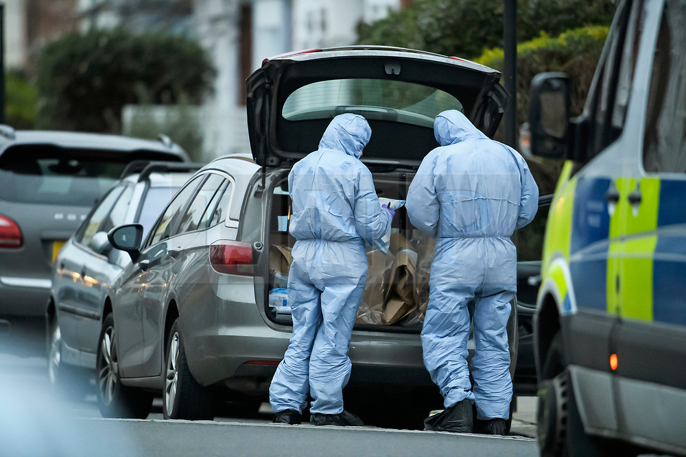 © Licensed to London News Pictures. 16/03/2019. London, UK. Police forensics place evidence in a car at the scene where a  29 year old man has been stabbed to death on Gowan Avenue in Fulham, West London. Photo credit: Ben Cawthra/LNP
