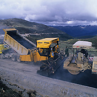 Heavy equipment paves a road on 14,830' Sisserkam La (pass), part of a major new highway linking Tibet & Szechuan that will accelerate cultural change.