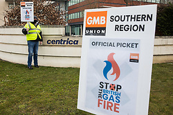 Windsor, UK. 8th March, 2021. A GMB member stands on a picket line outside the headquarters of Centrica, owners of British Gas. British Gas engineers and staff belonging to the GMB trade union began another in a series of 'Stop The British Gas Fire' strikes last week after overwhelmingly rejecting an offer by Centrica intended to resolve a dispute regarding rehiring on inferior terms and conditions. Centrica reported an operating profit of £901 million in 2019.