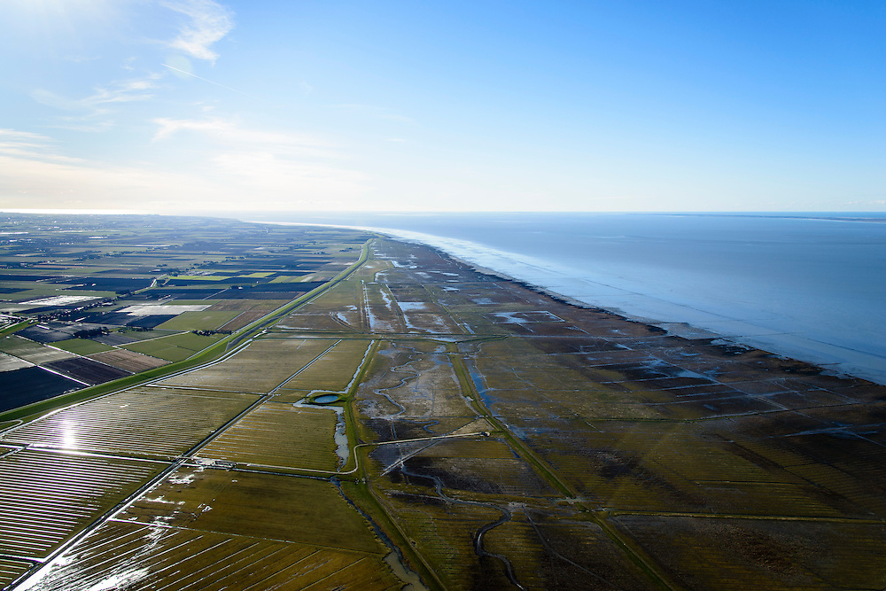 Nederland, Friesland, Gemeente het Bildt, 28-02-2016; buitendijks kweldergebied Het Noarderleech (NL: Noorderleeg), landaanwinning op de grens met het Friesche Wad. Dobbe met water voor het drenken van het vee.<br /> Land reclamation, Friese Wad, northern Friesland, tidal flat.<br /> <br /> luchtfoto (toeslag op standard tarieven);<br /> aerial photo (additional fee required);<br /> copyright foto/photo Siebe Swart