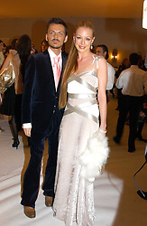 CAT DEELEY and her MATTHEW WILLIAMSON at the Moet & Chandon Fashion Tribute 2005 to Matthew Williamson, held at Old Billingsgate, City of London on 16th February 2005.<br /><br />NON EXCLUSIVE - WORLD RIGHTS