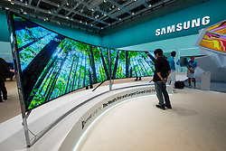 World's first and largest UHD curved TV by Samsung on display at IFA 2014 consumer electronics show in Berlin Germany