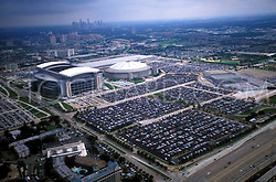 Aerial view of Reliant Stadium (now NRG Stadium) and the Astrodome with the downtown Houston, Texas skyline in background.