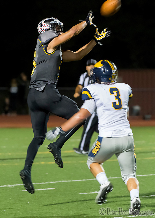 Del Oro Golden Eagle's Dalton Gee (5), \ctbfor a first down over the head of defender Oak Ridge Trojans Davis Lang (3), during the second quarter as the Del Oro Golden Eagles varsity football team host the Oak Ridge Trojans, Friday Oct 21, 2016.<br /> photo by Brian Baer
