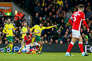 Norwich City midfielder Josh Murphy (11) makes a tackle Barnsley midfielder Adam Hammill (7) during the EFL Sky Bet Championship match between Norwich City and Barnsley at Carrow Road, Norwich, England on 18 November 2017. Photo by Phil Chaplin.