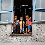 A family in Easterhouse, Glasgow look out over their balcony during the lockdown.Glasgow, Britain, 24 March 2020. EPA-EFE/ROBERT PERRY