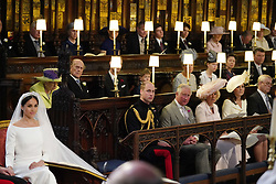 Meghan Markle in St George's Chapel, Windsor Castle for her wedding to Prince Harry watched by (middle row from left) Queen Elizabeth II, Duke of Edinburgh, Earl of Wessex, Viscount Severn, Countess of Wessex, Lady Louise Mountbatten-Windsor, Princess Royal, Sir Tim Laurence, (front row from left) Duke of Cambridge, Prince of Wales, Duchess of Cornwall Duchess of Cambridge, Duke of York. .