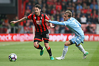 Football - 2016 / 2017 Premier League - AFC Bournemouth vs. Stoke City<br /> <br /> Marc Muniesa of Stoke City tries to grab Bournemouth's Adam Smith and stop him from setting up a Bournemouth attack at the Vitality Stadium (Dean Court) Bournemouth<br /> <br /> COLORSPORT/SHAUN BOGGUST