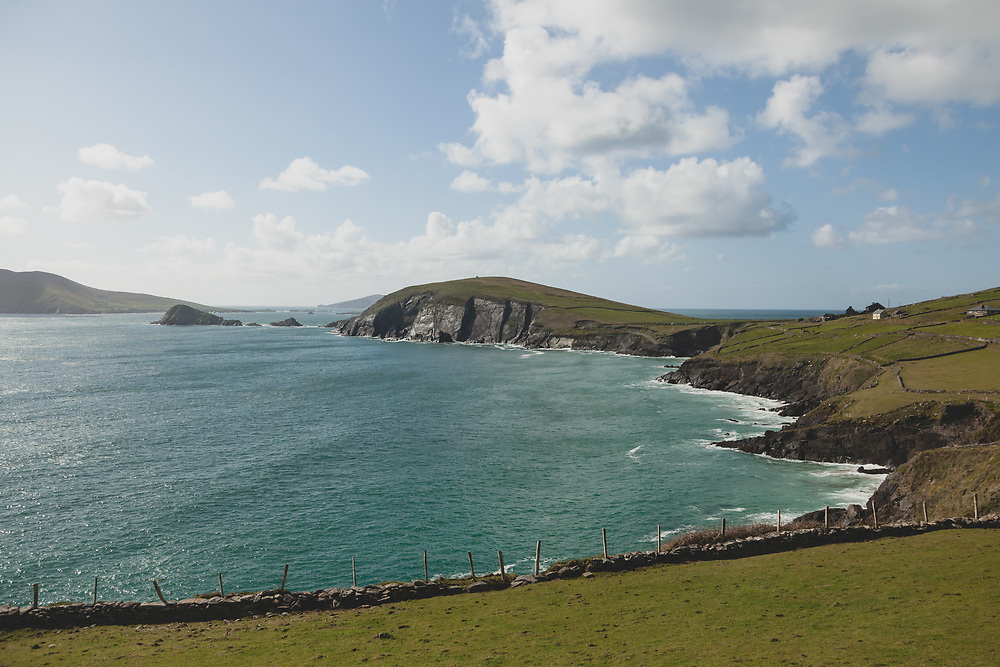 The vibrant green hillside and cliffs at Slea Head.