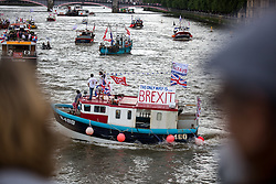 © Licensed to London News Pictures. 15/06/2016. London, UK. The pro-Brexit campaign 'Fishermen for Leave' are sailing a flotilla of over 30 vessels up the Thames. The flotilla, including UKIP leader Nigel Farage, caused traffic issues in central London, as vessels travelled up the Thames for high tide and to coincide with the last Prime Minister's Questions before the EU referendum takes place on 23 June. Photo credit : Tom Nicholson/LNP