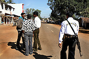 Members of the Salwa Judam militia stop and chat in the main street of Bastar in southern Chhattisgarh. Militia members are armed at all times giving the area the feel of the American Wild West.