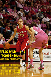 12 February 2012:  Katie Yohn works the offense against Katie Broadway during an NCAA women's basketball game Where the Bradley Braves lost to the Illinois Sate Redbirds 82-63.  It was Play 4Kay day in honor of the cancer research fund set up by Coach Kay Yow at Redbird Arena in Normal IL