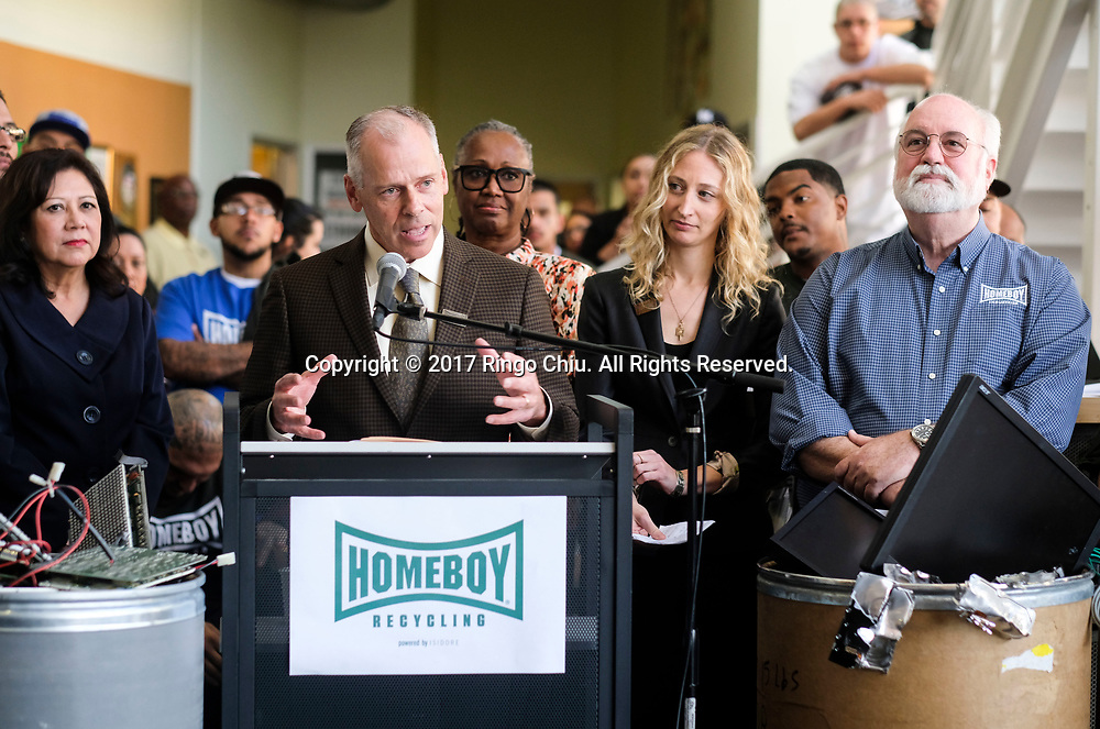 Father Greg Boyle, right, founder of Homeboy Industries; and Kabira Stokes, 2nd right, founder and CEO of Isidore Electronics Recycling look on as Tom Vozzo, center, CEO of Homeboy Industries speak in an event at Homeboy Industries in Los Angeles. (Photo by Ringo Chiu/PHOTOFORMULA.com)<br /> <br /> Usage Notes: This content is intended for editorial use only. For other uses, additional clearances may be required.
