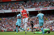 Mesut Ozil of Arsenal screams in anger as he misses a chance to score a goal. Barclays Premier League, Arsenal v West Ham Utd at the Emirates Stadium in London on Sunday 9th August 2015.<br /> pic by John Patrick Fletcher, Andrew Orchard sports photography.