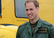 17/09/2010 - Scotland<br /> Graduation day for Prince William, the search and rescue helicopter pilot<br /> Prince William will today graduate as a Search and Rescue Force helicopter pilot and has expressed his delight at completing the 'challenging' course.<br /> The second-in-line to the throne will join 22 Squadron, C Flight as a fully operational co-pilot in a Sea King Mk3 helicopter now that he has completed his flying training.<br /> The prince, who will be based at RAF Valley on Anglesey, said: 'I am really delighted to have completed the training course with my fellow students.<br /> 'The course has been challenging, but I have enjoyed it immensely. I absolutely love flying, so it will be an honour to serve operationally with the Search and Rescue Force, helping to provide such a vital emergency service.'<br /> The 28-year-old prince has spent the last 18 months on a number of flying courses progressing from the Squirrel HT1 helicopter to a Bell 412EP Griffin and finally spending much of the last year at the controls of a4-man Sea King on an operational conversion unit to prepare him for his new role.<br /> At RAF Valley later today Flight Lieutenant Wales and six fellow students will be presented with their certificates and Search and Rescue Force badges by the unit's Commander, Group Captain Jonathan Dixon.<br /> A St James' Palace spokeswoman stressed the prince would not have any guests at the presentation.<br /> It will be a number of weeks before the royal embarks on his first 24-hour shift as he will have to undergo 'acceptance' training - familiarising himself with the the terrain and landing sites that he and his crew will be expected to cover.<br /> Photo Shows: Proud Prince: William stands today next to his Helicopter<br /> ©Crown Copyright/Exclusivepix