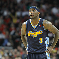 26 March 2012: Denver Nuggets point guard Ty Lawson (3) rests during the Denver Nuggets 108-91 victory over the Chicago Bulls at the United Center, Chicago, Illinois, USA. NOTE TO USER: User expressly acknowledges and agrees that, by downloading and or using this photograph, User is consenting to the terms and conditions of the Getty Images License Agreement. Mandatory Credit: 2012 NBAE (Photo by Chris Elise/NBAE via Getty Images)