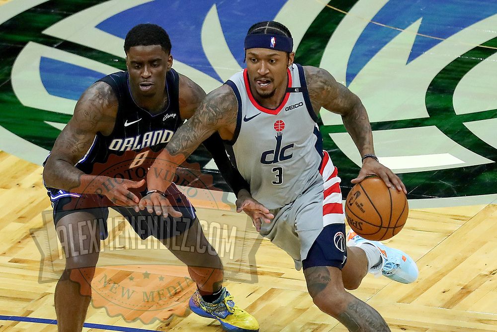 ORLANDO, FL - APRIL 07: Bradley Beal #3 of the Washington Wizards drives the ball past Dwayne Bacon #8 of the Orlando Magic at Amway Center on April 7, 2021 in Orlando, Florida. NOTE TO USER: User expressly acknowledges and agrees that, by downloading and or using this photograph, User is consenting to the terms and conditions of the Getty Images License Agreement. (Photo by Alex Menendez/Getty Images)*** Local Caption *** Bradley Beal; Dwayne Bacon