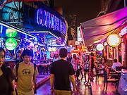 20 SEPTEMBER 2013 - BANGKOK, THAILAND: People on Soi Cowboy in Bangkok. Soi Cowboy is one of the notorious Entertainment Districts in Bangkok. Entertainment District has emerged as euphemism for red light district. Prostitution is officially illegal in Thailand but it is widely condoned. For western men, Soi Cowboy, along with Soi Nana and Patpong are among the most well known entertainment districts in Bangkok.      PHOTO BY JACK KURTZ