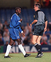 Jimmy Floyd Hasselbaink (Chelsea) complains to referee Mendoza Casrellano during the match. Chelsea v St Gallen, UEFA Cup, 14/9/2000. Credit Colorsport / Stuart MacFarlane.