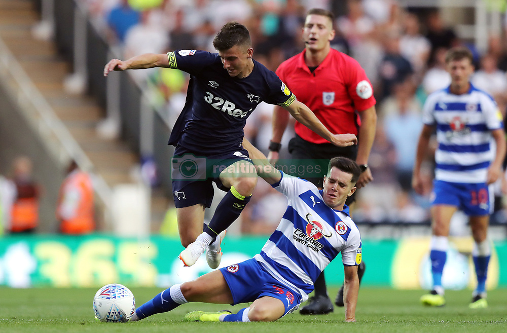 Derby County's Mason Mount (left) and Reading's Liam Kelly battle for the ball during the Sky Bet Championship match at the Madejski Stadium, Reading.