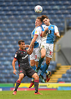 Blackburn Rovers' Hayden Carter and Joseph Rankin-Costello jump for the ball<br /> <br /> Photographer Dave Howarth/CameraSport<br /> <br /> The EFL Sky Bet Championship - Blackburn Rovers v Reading - Saturday 18th July 2020 - Ewood Park - Blackburn<br /> <br /> World Copyright © 2020 CameraSport. All rights reserved. 43 Linden Ave. Countesthorpe. Leicester. England. LE8 5PG - Tel: +44 (0) 116 277 4147 - admin@camerasport.com - www.camerasport.com