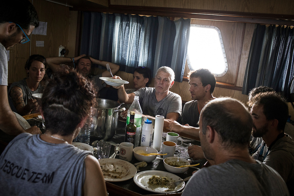 June 28th, 2017, Central Mediterranean. Crew at lunch while sailin to SAR zone. NGO Proactiva Open Arms in their 20th rescue mission in the Central Mediterranean Sea on board of Golfo Azzurro vessel (photo Edu Bayer)